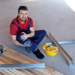 Worker suffering after on-the-job injury in building site